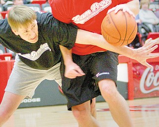 The Vindicator/Geoffrey Hauschild.Adam Tokash, of Covidien Sports Medicine drives downcourt whiled defended by Richard Cordray, Ohio's Attorney General, during the first half The Game of Hope, Charity Basketball game, benefitting local chronically and terminally ill children at YSU's Beeghley Center on Saturday afternoon.