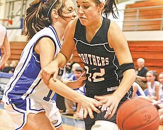 NICE PLAY: Hubbard's Krista Julian (10) knocks the ball away from Struthers' Dana Mathews during the first period Monday.