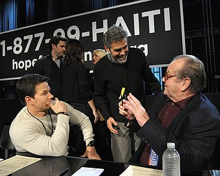 """In this image released by Hope for Haiti Now, actors, from left, Mark Wahlberg, George Clooney, and Jack Nicholson are shown at """"Hope for Haiti Now: A Global Benefit for Earthquake Relief"""", on Friday, Jan. 22, 2010, in Los Angeles. (AP Photo/Mark Davis, Hope for Haiti Now)"""