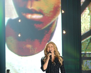 """In this image released by Hope for Haiti Now, Shakira performs at """"Hope for Haiti Now: A Global Benefit for Earthquake Relief"""", on Friday, Jan. 22, 2010, in New York. (AP Photo/Evan Agostini/Hope for Haiti Now)"""