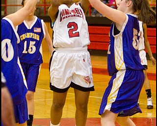 The Vindicator/Geoffrey Hauschild.Campbell's Iesha Moses (2) and Champion's Mackenzie Kiser (51) during the third quarter of a game at Campbell High School on Wednesday evening.