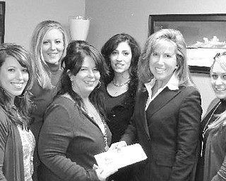 Special to The Vindicator HELPING HANDS: Howland's Lanai Salon, with a little ingenuity and the spirit of giving, took a corporate gift and turned it into a fundraiser for the Ireland Cancer Center at Trumbull Memorial Hospital. Salon employees created a gift basket worth nearly $500 and sold tickets to clients and the community for a raffle. The basket included a pink limited edition Paul Mitchell flatiron, a professional blow dryer and an array of other salon and spa products. In two months, the salon raised more than $900 for the cancer center. Fran Ruberto, a salon owner, said another raffle is in the works. The salon is at 165 Niles Cortland Road, in the Galleria Suites. For more information call Christine Ruggieri at (330) 240-4838. Above, Melanie Kush, Jen Ulp, Ruberto, Gina Cannell and Ashley Lokash, Lanai Salon employees, present a check to Christine Ruggieri, from the Trumbull Memorial Hospital Foundation.