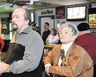 VALLEY VIEWERS: Jack Koscelansky and Dee Troll of Austintown watch the State of the Union address at Ball Busters Sports Bar in Austintown.