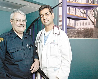 AWARD WINNER: Dr. Chakri Yarlagadda, right, is in his native India this week to receive the Hind Rattan (Jewel of India) Award given annually to nonresident Indians in recognition of their services, achievements and contributions in their fields. Dr. Yarlagadda, a cardiologist and vice president of the Ohio Heart Institute here, is accompanied on the trip by his friend Stephen Gerish, left, of Canfield, a load-limit inspector for the Ohio State Highway Patrol.