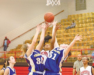 ALL FOR ONE: Campbell Memorial's Iesha Moses, center, goes up for a rebounds against Champion's Haley McAllister (35) and Mackenzie Kiser (51) during the third quarter of Wednesday's All-American Conference game. The Red Devils won 35-32.