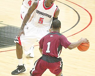 DOUBLE-TEAMED: Youngstown State's Sirlester Martin (5) and Vance Cooksey (4) defend against Michael Glasker (1) of North Carolina Central during Wednesday's game at the Beeghly Center. YSU won the game 70-57.
