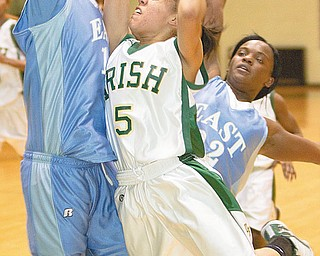 PANTHERS HOLD OFF IRISH: Ursuline's Aurielle Irizzary (5) takes a shot but is fouled while defended by East's Briana Dawson (10) and Lesa Monet Oliver (22) during the second quarter of Thursday's game at Ursuline High School. Irizzary put up 16 points, but the Irish fell to the Panthers, 50-45.