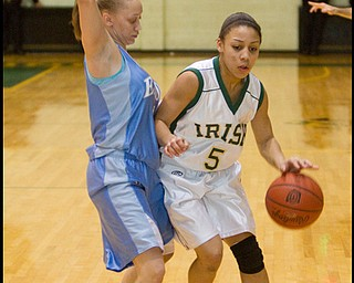 The Vindicator/Geoffrey Hauschild.Ursuline's Aurielle Irizzary (5) makes her way down court while defended by East's Alex Hines (5) during the second quarter of a game at Ursuline High School on Thursday evening.