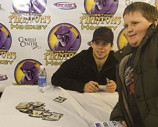 Robert Nottingham (9) of Struthers poses with Pittsburgh Penguins Center Tyler Kennedy (48) at his meet and greet with fans at Covelli Centre Friday evening before the Phantoms game against the Sioux Falls Stampede.