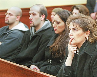 VICTIM'S SISTER: Terri Rasul, right, of Youngstown, a sister of slain shopkeeper Isam Salman, listens to legal arguments during a 7th District Court of Appeals hearing Tuesday on whether Mark Aaron Brown should get a new trial for the 1994 murder of her brother and Hayder Al-Turk, a clerk at the Midway Market on Elm Street. Other members of the victims' families are at left. Brown's execution is set for Thursday.