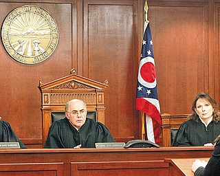 ATTENTIVE JUDGES: Judges Mary DeGenaro, left, Gene Donofrio and Cheryl L. Waite of the 7th District Court of Appeals hear Atty. Rachel Troutman, back to camera, make a last-minute appeal Tuesday for a new trial for Mark Aaron Brown, who faces execution Thursday for the 1994 murders of a North Side convenience store owner and clerk.