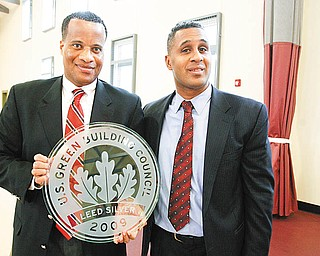 GREEN AWARD: Youngstown Mayor Jay Williams, left, accepts the U.S. Green Building Council's Leadership in Energy and Environmental Design Silver Award from Clifford Scott, director of the Youngstown Metropolitan Housing Authority. The presentation was Tuesday at the Arlington Heights Recreation Center, the building that won the award. The city owns and operates the recreation center.