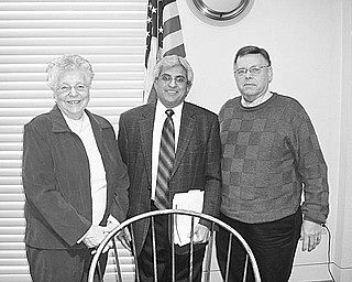 Special to The Vindicator INFORMATIVE: An informative talk on the political climate in the Mahoning Valley and an insightful discussion of the upcoming census-taking was presented by Bertram de Souza, editorial writer for The Vindicator, at the January meeting of Austintown Friends of the Library. Joining de Souza following his remarks were Dorothy Fizet and Doug Wilcox, leaders of the Friends. Speaking at the 10 a.m. Feb. 8 meeting of the Friends will be Christopher Barzak, Youngstown State University instructor.