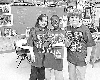 Special to The Vindicator MAKING A CHANGE: Students at St. Patrick School have been doing their part to support research for a cure for cancer. The children deposited loose change in buckets that had been placed in each classroom. As a result, more than $400 was collected for the American Cancer Society. Displaying one of the buckets are members of Mrs. Yambovich's fourth-grade class, from left, Samantha Rosser, Guy-Michel Kaho and Daniel Robinson, who shared the spirit of giving.