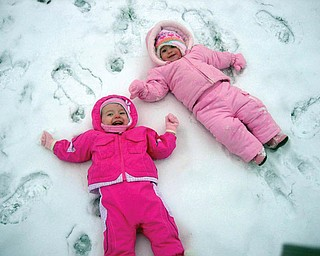 Kalynn Robenolt of Austintown, daughter of Amanda Robenolt, and Ryleigh DeLisio of Boardman, daughter of Abbi DeLisio, enjoy playing in the snow.
