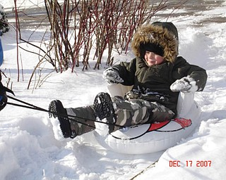 Preston English of Boardman was 2 in this picture as he was being pulled on the sled by Grammie..