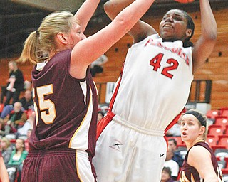 EFFORT DOUBLED: Loyola's Brittany Boeke (55) blocks Brandi Brown (42) of Youngstown State as Brown goes for the basket during Thursday's game at YSU's Beeghly Center.  Brown posted a double-double for the Penguins, who were narrowly defeated by the Ramblers, 63-59.