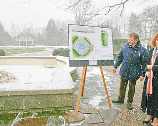 LOOKING FORWARD: Linda Kostka, Mill Creek MetroParks marketing and development director, and Keith Kaiser, parks horticulture director, explain the Seasonal Celebration Plaza plans, which outline the renovation of the Sommer Fountain and surrounding area in Fellows Riverside Gardens. Kaiser said the fountain, built in 1977, was turned off in 2008 because of failing mechanics. The $500,000 construction project is slated to begin in April and should be completed by midsummer.
