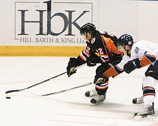FOCUSED: Adam Berkle (22) of the  Youngtown Phantoms drives past the Indiana Ice's Anthony Bitetto during Wednesday's game at the Covelli Centre.  January was a bad month for the Phantoms, who went 1-9, and February didn't start out much better, with a 5-1 loss to the Ice. But, with only 22 games remaining, the team is determined to improve beginning this weekend against the Waterloo Black Hawks.