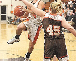 SPRINGFIELD - EAST PALESTINE - (4) Andria Lyons drives to the hoop as (45) Chelsea Stewart plays defense during their game Thursday night in Springfield. - Special to The Vindicator/Nick Mays