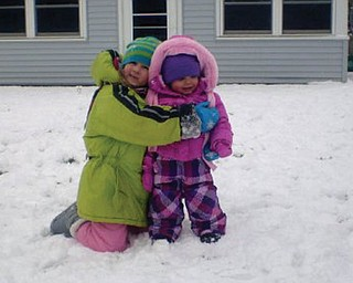 Gina Milone, 6, and Lorelai Nemes, 17 months, both of Struthers. This was LorelaiÕs first time in the snow, and Gina is her best friend and neighbor..