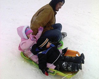 Dad,Buddy, with daughter Kayla from New Middletown and friend Nathan from Mineral Ridge sledding at Mill Creek Park.