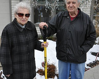 Ann & Alex Wasylychyn of YoungstownÕs West Side get ready to shovel snow at there sonÕs house. Alex is 85-years-old and Ann is 83-years-old.