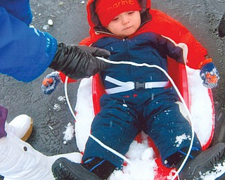 Tyler Vincent Babyak, 15 months, of Safety Harbor, Fla., was at his grandparentsÕ home in Poland for the holidays when he experienced his first snow and sled ride. He is the son of Krista (Bell) and Vince Babyak..