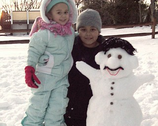 9-year-old Paul and 3-year-old Hannah Proctor of Youngstown built a Mario Snowman..