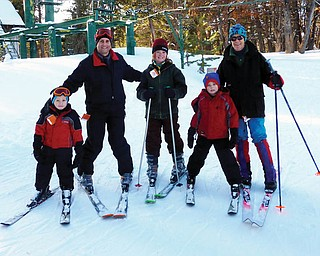 Poland residents Alex, John and Nicholas LaPlante, all of Poland, went skiing at the Medicine Bow Ski resort during a recent trip to Wyoming to visit family for Christmas. Also pictured are a cousin, Venice Sheehan, and aunt, Suzie Spencer..