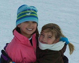 Alyssa and Tara Santoro are enjoying playing on a snow day while off from school at C.H. Campbell in Canfield. They are the daughters of Nick and Amy Santoro..