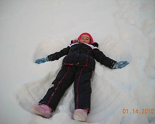 Zoe LaRosa, 4, of Boardman, decided to make a snow angel when she and her brother, David, went sled riding for the first time in Poland. She is the daughter of Danielle and David LaRosa..