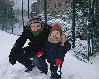 Sinan Emrys Dunn, 18 months, is the son of Drs. Cory (formerly of Liberty Township) and Gulayse Dunn of Istanbul, Turkey, and grandson of Lynn and Dave Dunn of Liberty Township. Grandma says it doesnÕt typically snow there. Sinan didnÕt like it but his daddy did!.