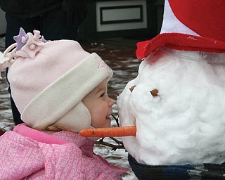 CLOSEUP: Jaime Hoefert, 2, is getting to know her new winter friend at Terrytown Gift shop in North Lima..
