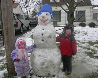 Landon and Lanie Joyce, ages 3 and 1, of Boardman, built their first snowman of the year with help from their mom and dad, Casie and David Joyce..