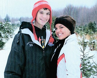 Matt Chuey and his sister, Sarah, both of Poland, stopped long enough for a picture while picking out the family holiday tree..
