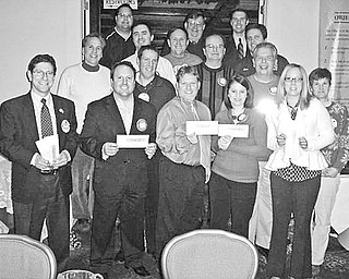 Special to The Vindicator IN HIGH GEAR: Plans for a fundraising reverse raffle to be March 6 at the Maronite Center have been completed by members of the Rotary Club of Austintown. Tickets  for the event are $150 and include appetizers and beverages at 6 p.m. two lavish dinners at 7, and dancing. The cost for the mini board side raffle is $25, and there will be a Chinese auction. Proceeds from the evening will be applied to scholarships, the Woodside Reads Program, dictionaries for all area third graders, library contributions, Junior Achievement programs and local, national and international polio, water and education projects. Prepared for the sale of tickets are, row 1 from left, Dr. Mitch Dalvin, Mike Sciortino, Karl Rein, Deanna Spirko and Rachel Solida; row 2, Toby Mirto, Frank Santisi, Ron Carroll, Bruce Laraway and Hillary Prestridge; row 3, Dave Buttar, Gary Reel and Brian Frederick; and row 4, Michael Cafaro, Bob Senn and Brian Laraway.