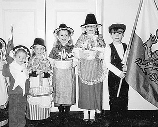 Special to The Vindicator CARRYING ON TRADITION: Youngsters will have an opportunity to take part in a traditional St. David's celebration on Feb. 27 in New Castle, Pa. The children don traditional Welsh attire and carry the Welsh flag and daffodils as they practice for their appearance at the event. 1