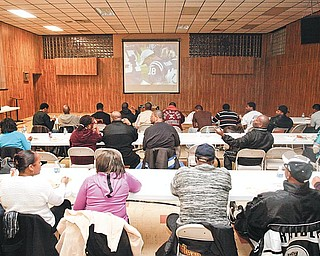 GAME ON: Attendees of Rising Star Baptist Church's Super Bowl party Sunday root on their favorite team. The nonalcoholic, family-oriented party is an annual event at the church, located on Wardle Avenue in Youngstown.