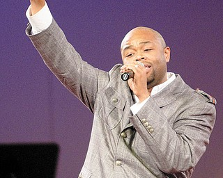 """MOVING TRIBUTE: Marvin Winans  Jr. sings """"You Never Let Me Down"""" at Victory Christian Center in Coitsville during a memorial concert Monday evening for Bishop Norman L. Wagner, pastor of Calvary Ministries International, who died Jan. 30. A capacity crowd of about 2,000 attended the event, which featured a star-studded cast of Grammy-Award winning Gospel musicians."""