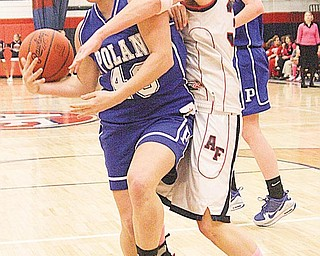 Adriana Sikora (40) of Poland and Stephanie Berdis (35) fight for the ball during their game Monday night in Austintown.