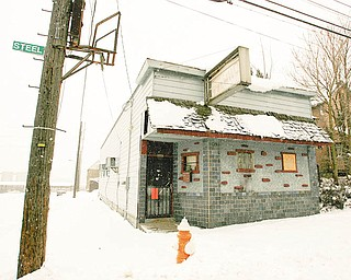 DOG HOUSE CLOSED: The Afro Dogs Motorcycle Club had used this building at 725 Steel St. on the West Side as a social hangout. The building, however, is on the city's demolition list. Police also found illegal utility use and a stolen motorcycle at the former bar.