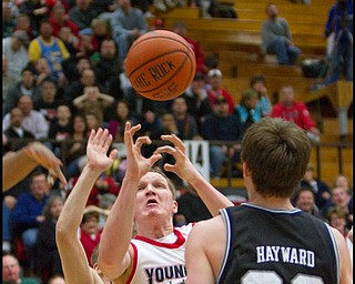 The Vindicator/Geoffrey Hauschild.YSU's Vytas Sulskis (44) reaches for a rebound while blocked by Butler's Zach Hahn (3) and Gordon Hayward (20) during the second half of a game at YSU's Beeghley Center on Thursday evening.
