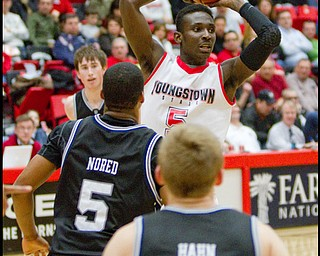 The Vindicator/Geoffrey Hauschild.YSU's Sirlester Martin (5) looks for the open man during the second half of a game at YSU's Beeghley Center on Thursday evening.