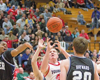 UNDEFEATED BULLDOGS: Youngstown State's Vytas Sulskis (44) grabs for a rebound while being blocked by Butler's Ronald Nored (5), Zach Hahn (3) and Gordon Hayward (20) during the second half of Thursday's game at YSU's Beeghly Center. The Penguins lost another one to the Bulldogs, who with the 68-57 win remain undefeated in the Horizon League.