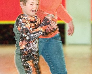 "The Vindicator/Geoffrey Hauschild.Liberty resident, Candy Day pulls her son, Cody Day, age 5, around the rink at Skate Zone in Austintown on Thursday afternoon. ""We came last year alot,"" said Candy, ""my kids really love it and the price is pretty good."".1.21.2010.Skate Zone InFocus"