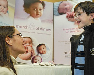 ALL SMILES: March of Dimes 2010 national ambassador, Joshua Hoffman of Weston, Fla., got some pointers from his mother, Melanie, on the speech he was about to deliver Tuesday to the MOD Mahoning Valley March for Babies Leadership Luncheon.
