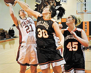 LeBrea's Courtney Aldridge (21) tries to shoot over East Palestine's Brooke Gedon (30) and Chelsea Stewart(45) during theirgame at MideralRidge onMonday night.  Photo/Mark Stahl