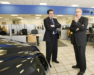 Robert K. Yosay /The Vindicator. Greg Greenwood   listen as Mark Reuss President GM North America tells about how the Cruze was comfortable and fun to drive as he drove down from Detroit to visit the Austintown Dealership -30-