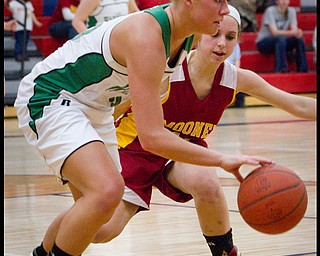 The Vindicator/Geoffrey Hauschild.West Branch's Michele Sosnick (30) dribbles down court while defended by Mooney's Angela Stana (15) during the third quarter of a game at Autintown Fitch High School on Wednesday evening.